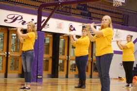 Senior Heather Brown and fellow flute players during the pep session Friday.