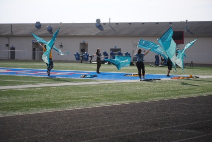 The color guard practice at Martinsville before performing at Lucas Oil Stadium.