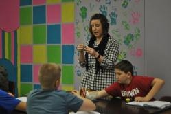 Mrs.Bough explains directions on the molecule lab.