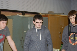 Sophomores Tanner Phillips, Codie Emmons, and Wyatt Schneider look at notes.
