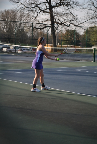 Freshmen Emma Osborn, serving the ball during the first tennis match of the season against Forest Park.